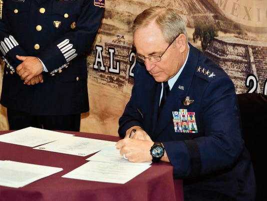 Air Force Chief of Staff Gen. Mark A. Welsh III signs an agreement at the conclusion of the Conference of American Air Chiefs June 25 in Mexico City. The CONJEFAMER, as it's known in Spanish, is an annual event sponsored by the System of Cooperation Among American Air Chiefs, which is headquartered at Davis-Monthan Air Force Base, Arizona and includes representatives from 20 Western Hemisphere air forces.