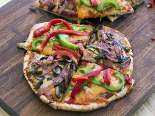 Making personal pizzas at home isn't as difficult or time-consuming as you might think.