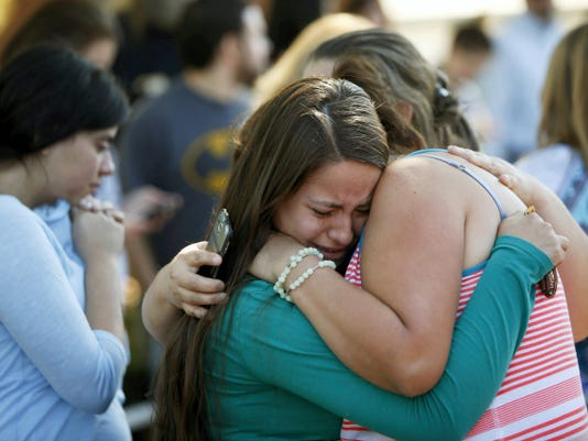 Jessica Vazquez, left, hugs her aunt, Leticia Acaraz, as they await word on Acaraz's daughter after a deadly shooting at Umpqua Community College, in Roseburg, Ore., on Thursday, Oct. 1, 2015. (Andy Nelson/The Register-Guard via AP)