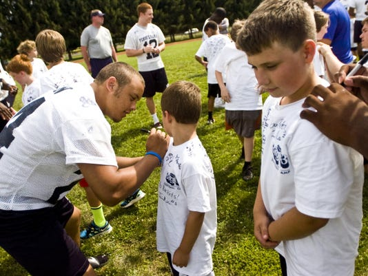 FILE -- GameTimePA.com Southwestern graduate Mike Felton signs autographs for kids during the Big 33 youth football clinic at Lower Dauphin High School in 2012. Felton now plays for Temple.