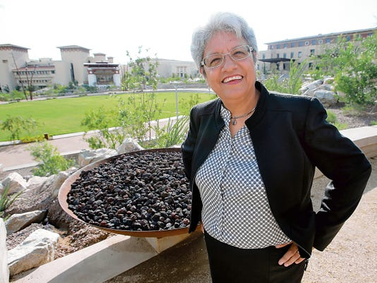 Rosa Orenstein returned to El Paso to speak at the Yetter Law School Preparation Dinner. She is a successful Dallas lawyer who grew up in the Segundo Barrio and attended Bowie High School. The UTEP Centennial Plaza is behind her.