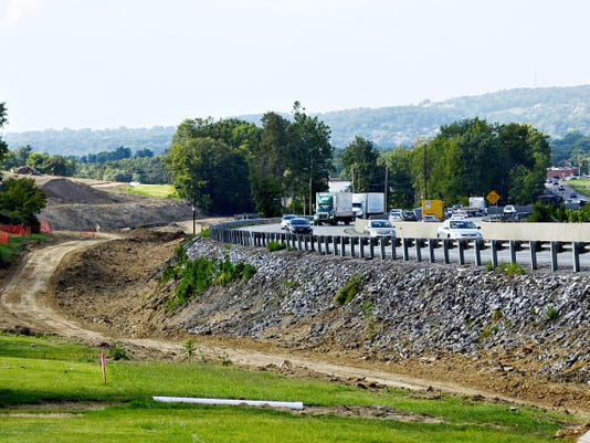 A barren construction zone lies next to Interstate 83 in Spring Garden Township, where trees separating the homes on Randow Road and the interstate were recently removed from in preparation for the building of a sound barrier.
