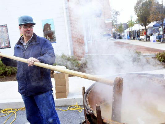 Titus Wadel of Cheesetown Produce Farm makes apple butter Saturday during AppleFest in Downtown Chambersburg.