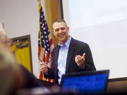 U.S Rep. Scott Perry talks with constituents during a town hall meeting in 2014.