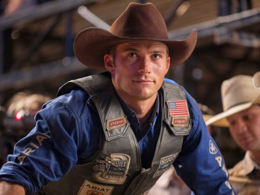 """In this photo provided by Twentieth Century Fox , Scott Eastwood portrays Luke, a former champion bull rider looking to make a comeback in a scene from the film, """"The Longest Ride,"""" directed by George Tillman, Jr. The movie releases in the U.S. on April 10, 2015."""