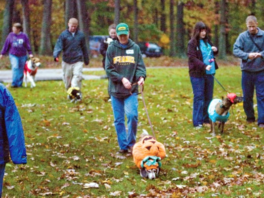 Pet owners walk their pets around Codorus State Park afternoon during the Bark 'n Boo pet parade in 2008. The pet owners walked their pets through a section of the campground for campers to see. The parade was in conjunction with Halloween in the Park, which will take place Oct. 23 and 24 this year.