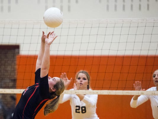 Hanover's Kelsey Staub attempts to set the ball for an attack toward Delone's court Tuesday night Sept. 29, 2015 at Hanover High School. Delone won in three games against Hanover.