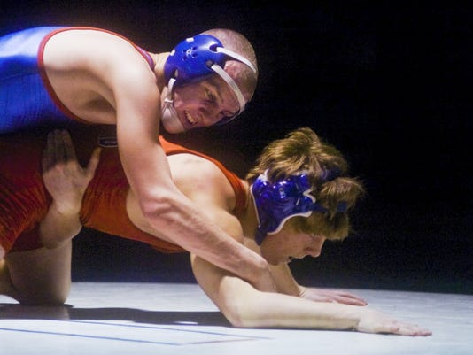 Spring Grove's Dakota Laughman works on pinning New Oxford's Kevin Moser during the 132-pound bout on Thursday at New Oxford High School. Laughman pinned Moser in 1:53 to secure his 100th win, and the Rockets remained undefeated with a 37-31 victory. (Shane Dunlap -- GameTimePA.com)