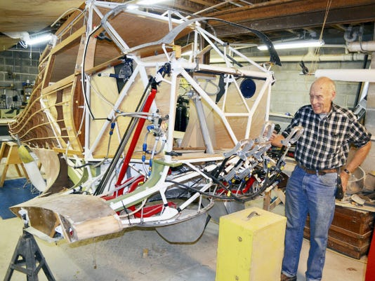 """Saying it's like building a model plane only bigger, Warren """"Doc"""" Daugherty explains the configuration of the rudder pedals he fabricated for the Staggerwing plane under construction. The pedals are just a few of the 10,000 parts that are going into the plane."""