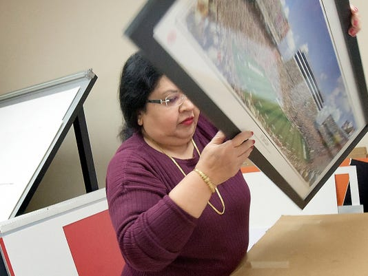 Art and Framing Warehouse owner Gayle Shadrach frames a print at her York City shop Wednesday. Shadrach has owned the custom framing business for 27 years, and she is concerned about how a proposed sales-tax increase could affect her business.