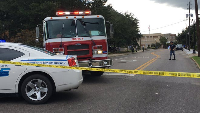 Authorities investigate a suspicious package at the federal courthouse in downtown Hattiesburg