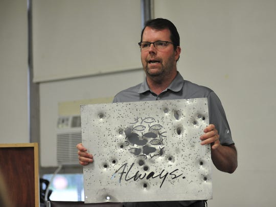 Rob Couturier holds an aluminum-alloy plate that would