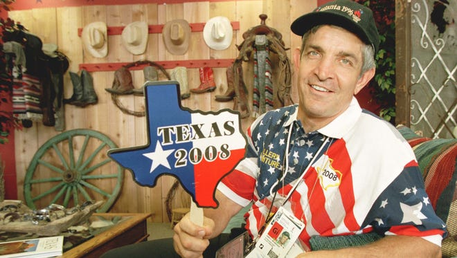 As far back as 1996, when this picture was taken during the Summer Olympic Games in Atlanta, owner Jim McIngvale of Gallery Furniture in Houston has been a booster, in this case pushing for Texas as an Olympic venue in 2008.