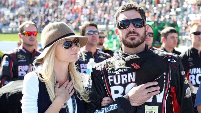 Martin Truex Jr. stands with girlfriend Sherry Pollex for the national anthem before the Oct. 26 Sprint Cup race at Martinsville Speedway, just the third race Pollex has attended since surgery Aug. 15.