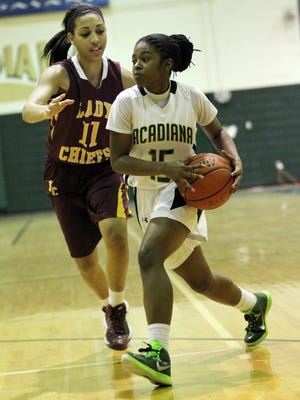 Natchitoches Central senior guard Princess Cohen (11) scored a game-high 26 points to lead Natchitoches Central to a 70-46 win over Acadiana in the second round of the Class 5A playoffs Monday night.