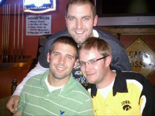 Jonathan Wieseler, right, is shown with his friends Adam Santi and Jason Moore in this contributed photo. Wieseler was killed in April.