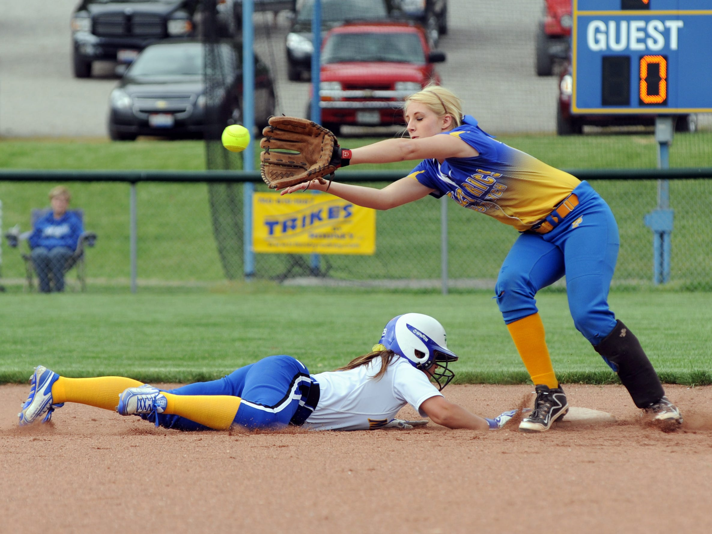 Maysville's Caitlynn Lingle slides safely back into second base past Philo's Mallory Hill in the third inning of a sectional tournament game Wednesday in Duncan Falls. Maysville defeated Philo, 8-3, advancing to the sectional finals.