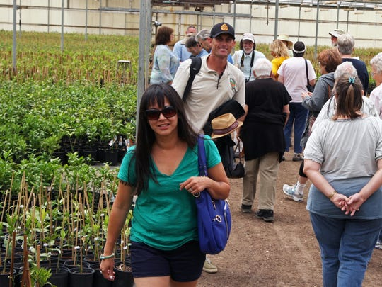 Aaron Dillon, center, greets visitors during the Monterey Bay Greenhouse Growers open house