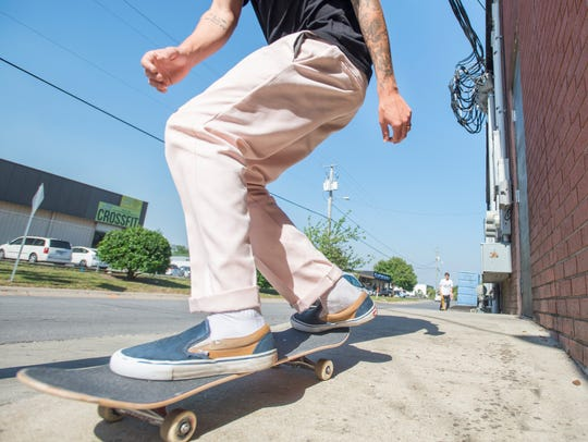 Chase Marcanio skateboards along East Heinberg Street