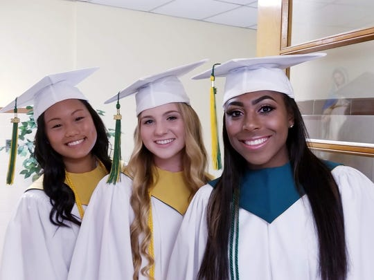 (From left) Grace HyoRee Bernard of Landisville, Angela D'Adamo of Waterford Works and Iyanla Sakile Kollock of Newfield, members of the Class of 2018, prepare to attend the Baccalaureate Mass during Our Lady of Mercy Academy's graduation.