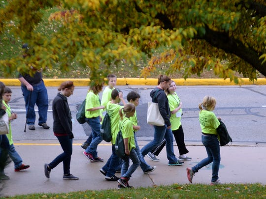 Groups of Phuture Phoenix program participants walk the campus at UW-Green Bay to get a feel for what attending college would be like. The program for middle school students is designed to promote college attendance.