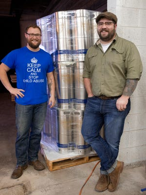 James Bridwell, left, and Will Meiron, right, get ready to open a new microbrewery on China Street called Sockdolager.