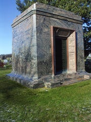 The rainbow granite mausoleum for Patrick Henry Alexander,