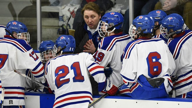 Pete Matanich talks with Apollo High School players during a hockey game last season. Matanich was the head coach at Apollo for seven seasons before the Eagles and St. Cloud Tech made a co-op team this season that he will coach.
