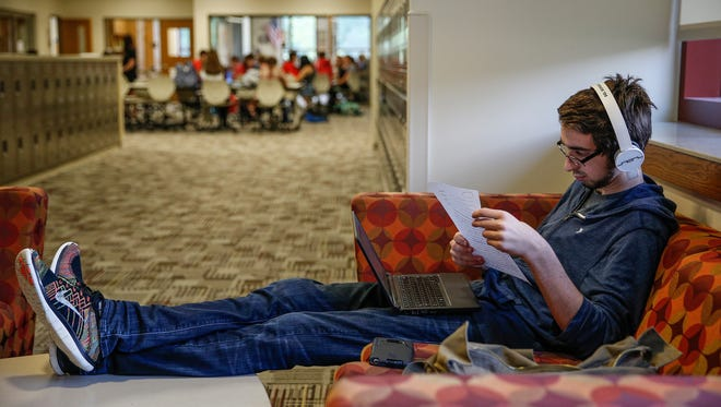 """Quintin Miller, a senior at Fishers High School, writes a commencement speech for his English class on Thursday, May 18, 2017. """"I enjoy the open feel, being able to sit in groups or work alone in our own area,"""" said Miller. """"It feels like the students are more in charge."""""""