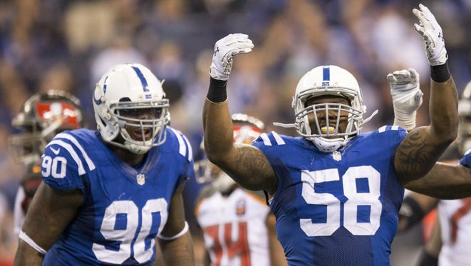 Indianapolis Colts defensive end Kendall Langford (90) (left), cheers on teammate Trent Cole after a cole sack of James Winston, Tampa Bay Buccaneers at Indianapolis Colts, Lucas Oil Stadium, Indianapolis, Sunday, Nov. 29, 2015. Indianapolis won 25-12.
