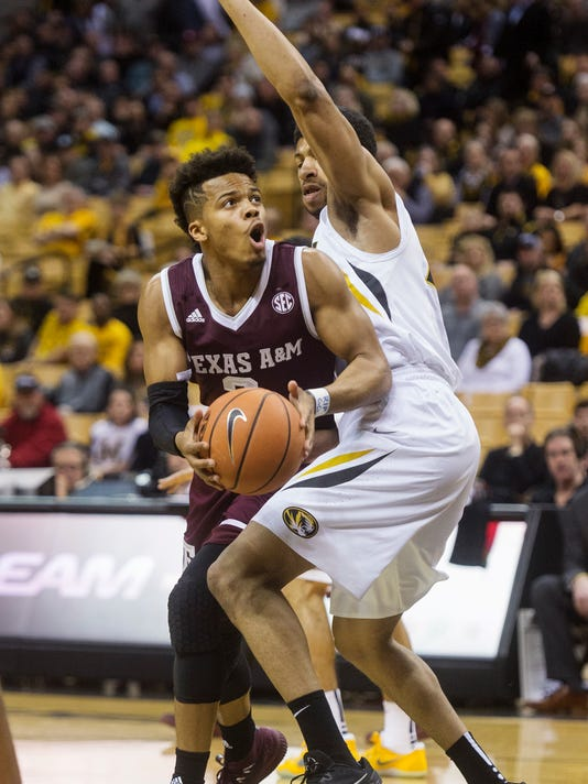 Texas A&M's Admon Gilder, left, dribbles around Missouri's Jordan Barnett, right, as he shoots during the first half of an NCAA college basketball game Tuesday, Feb. 13, 2018, in Columbia, Mo. (AP Photo/L.G. Patterson)