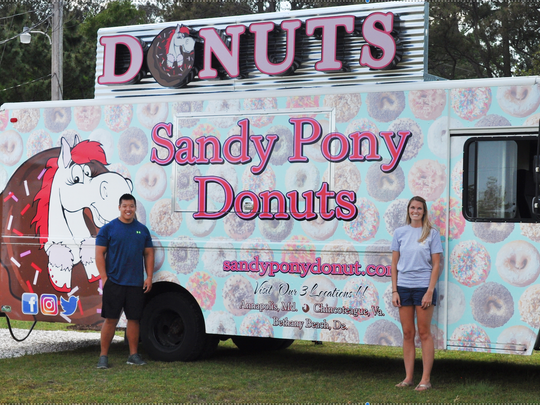 Ben Wang and Brea Reeves at their new donut truck in Bethany. Photo courtesy of Sandy Pony.