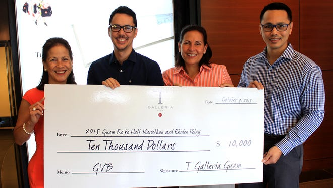 The Guam Visitors Bureau has received $10,000 dollars in support from T Galleria by DFS during a recent check presentation. T Galleria by DFS has committed to being a major sponsor of the 2015 Ko'ko' Half-Marathon and Ekiden Relay. The company has given $8,000 in cash and $2,000 in prizes hand-selected for the race winners. Shown at the presentation are, from left: Joann Camacho, T Galleria by DFS director of market development; Nathan Denight, GVB general manager; Telo T. Taitague, GVB deputy general manager; and Christopher Duenas, T Galleria by DFS director of operations and control.