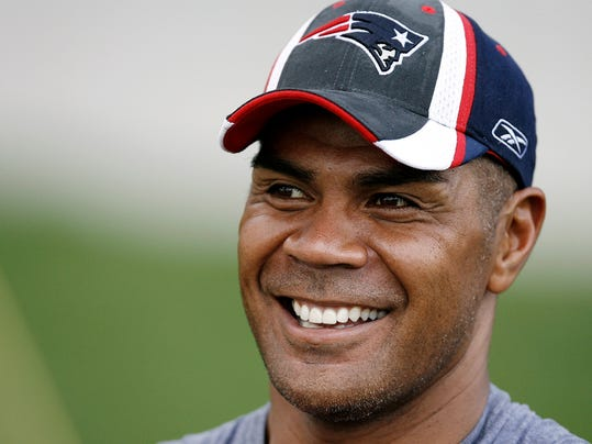 FILE - This July 28, 2007 file photo shows New England Patriots linebacker Junior Seau smiling during NFL football training camp in Foxborough, Mass. The family of Junior Seau has opted out of the proposed NFL settlement with former players over concussion-related injuries. The family will continue its wrongful death lawsuit against the league. Seau, a star linebacker for 20 seasons who made 11 Pro Bowls, committed suicide in 2012. (AP Photo/Winslow Townson, File)