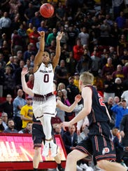 ASU's Tra Holder shoots a long three in an attempt