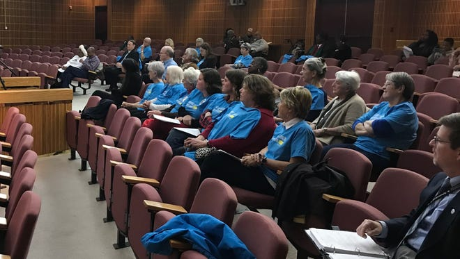 Supporters of juvenile justice reform in blue shirts speak to the Pensacola City Council on Thursday, Feb. 8, 2018.