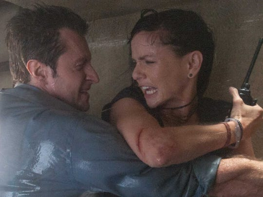 "Richard Armitage and Sarah Wayne Callies appear in a scene from ""Into the Storm."""