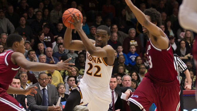 Iona senior guard Sean Armand (22), seen here driving to the hoop against Rider on March 2 at the Hynes Center, will have at least one more game in a Gaels uniform. The team plays at Louisiana Tech Wednesday night in the first round of the NIT.