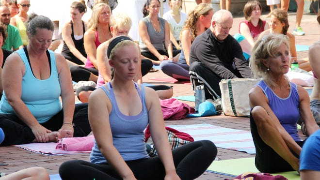 The fourth annual Yoga on Church Street event drew almost 400 people to the top block of Church Street in Burlington on Sunday.