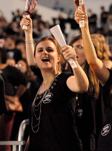 Mississippi State student Rachel Gaines rings her cowbell and yells during the second half of an NCAA college football game against Kentucky in Starkville, Miss., Saturday, Oct. 24, 2015. (AP Photo/Jim Lytle)
