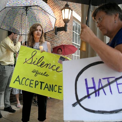 People attend a Stand in Solidarity with Charlottesville