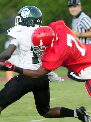 Trinity running back Dalyn Dawkins is tackled by Brentwood Academy's  Jalen Ramsey on Aug. 19, 2011.