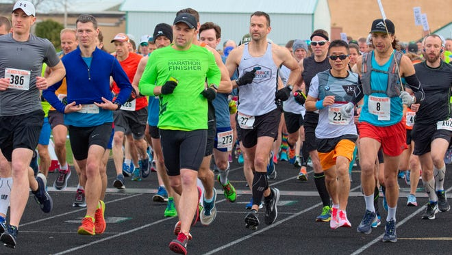 Runners get started Saturday morning at the 11th annual Lake Wobegon Trail Marathon.