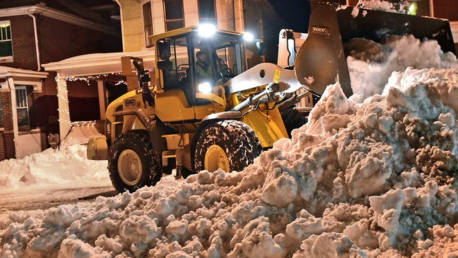 A crew from David H. Martin remove snow from West Washington Street, Chambersburg, Monday evening, Jan. 25, 2016. The borough of Chambers scheduled snow removal for Main Street downtown which staterted at 9p.m.