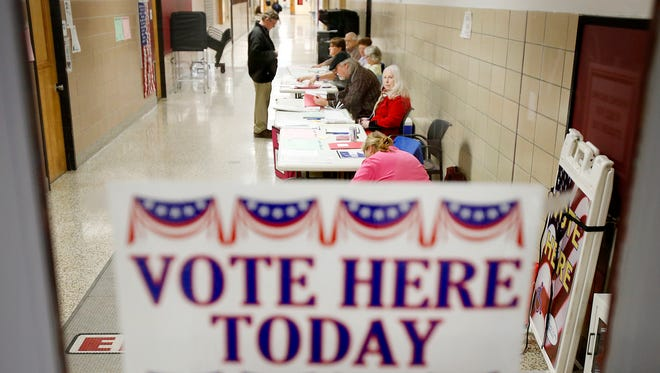 Pat Saxe checks in before casting his vote in the New York presidential primary Tuesday at Ernie Davis Academy polling site in Elmira.