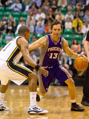 April 4, 2012: Phoenix Suns point guard Steve Nash (13) dribbles up court while defended by Utah Jazz point guard Earl Watson (11) during the first quarter at Energy Solutions Arena.