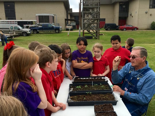 Third-graders learn about seeds and plants Thursday at Ag Day at Tioga High School.