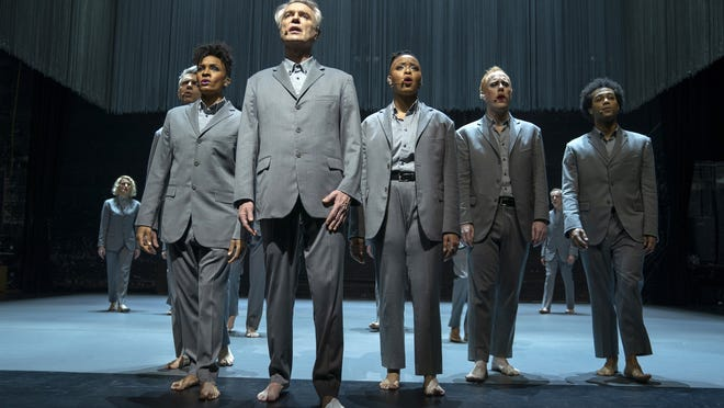 "David Byrne, foreground, appears in ""David Byrne's American Utopia."""