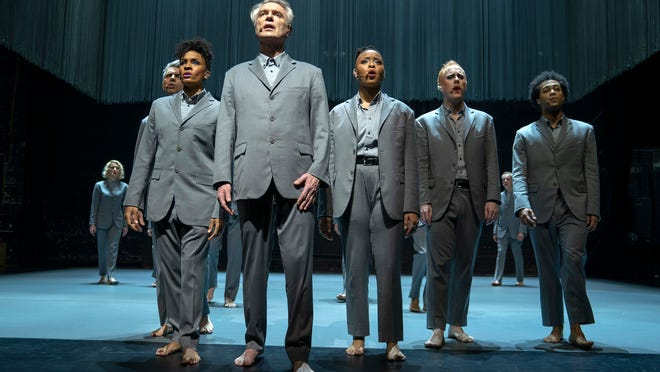 "David Byrne, foreground, in a scene from ""David Byrne's American Utopia."""
