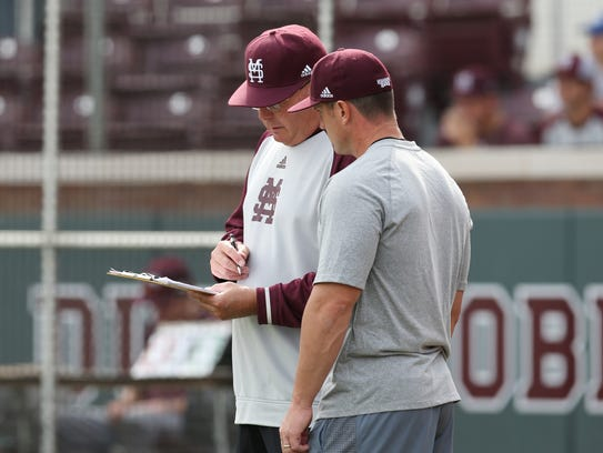 Gary Henderson, left, has been promoted to interim head coach of Mississippi State.